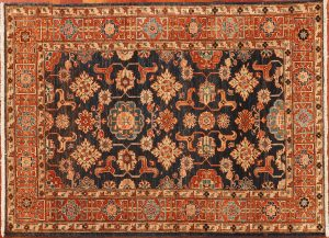 Azerbaijan is where this modest Oriental rug starts its long history. Still beautiful after hundreds of years and generations of weavers.
